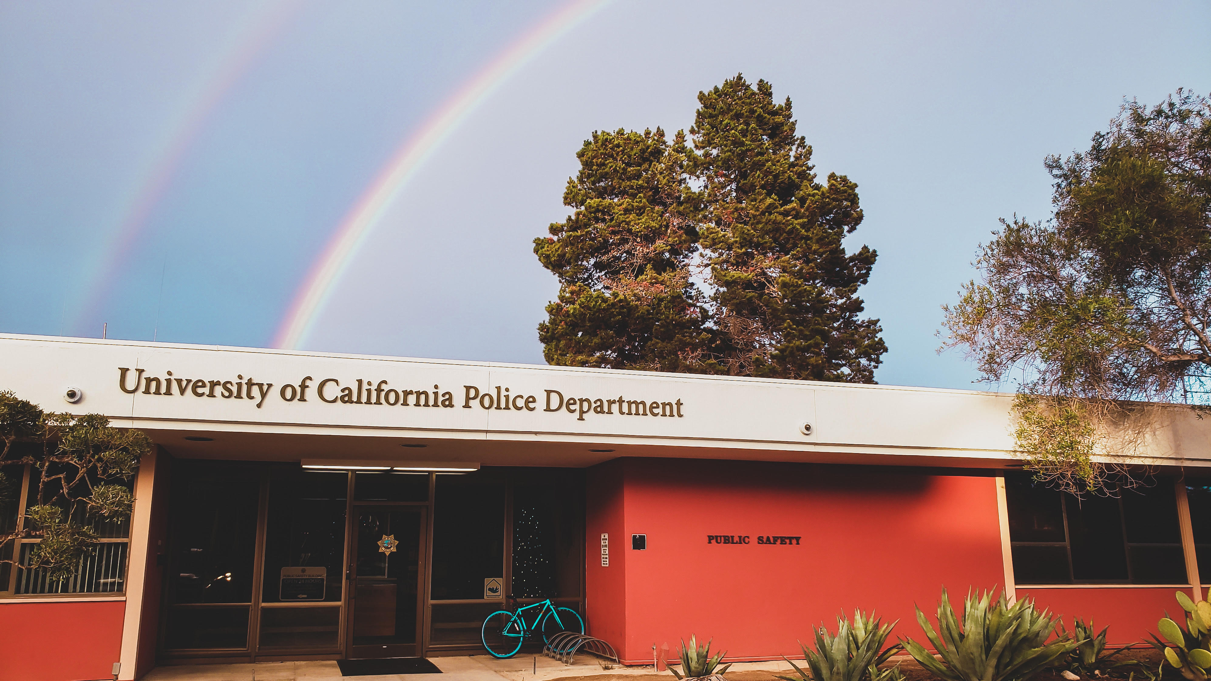 UCSB Police Station with rainbow in background